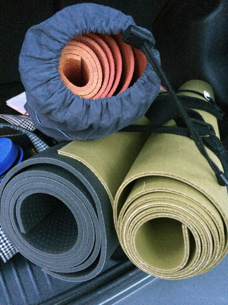 3 yoga mats in trunk