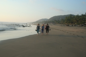 Beach walkers on Troncones