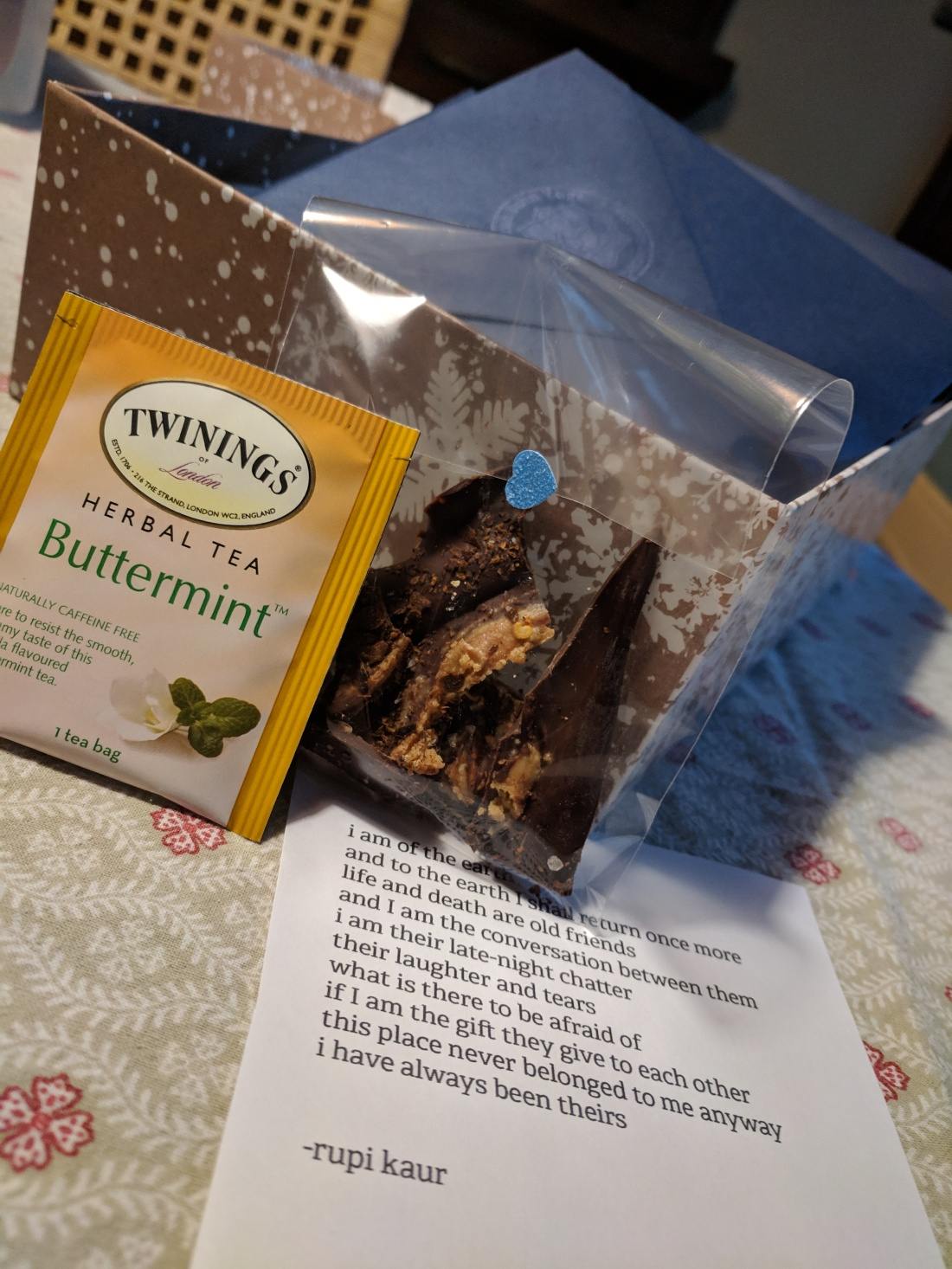 Buttermint tea packet, spicy chocolate bark and rupi kaur poem